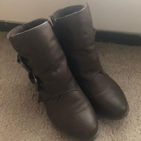 Brown booties with black buckles